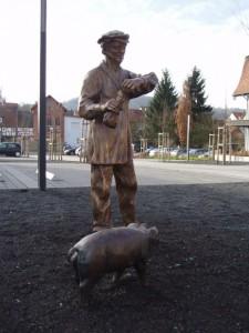 Bauer mit Schwein